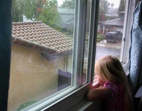 little girl window rainy day