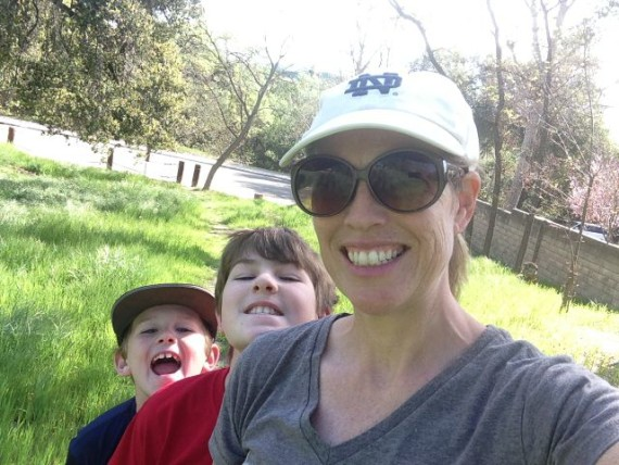 mom and boys hiking