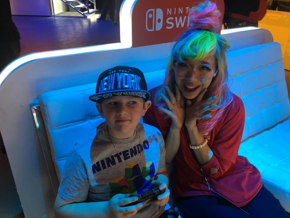 video game player and girl with multicolored hair