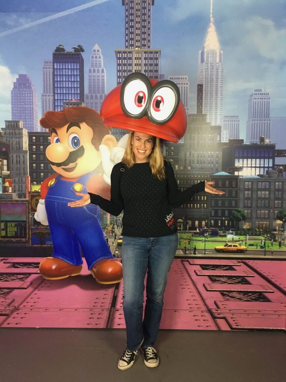 woman under giant Mario hat