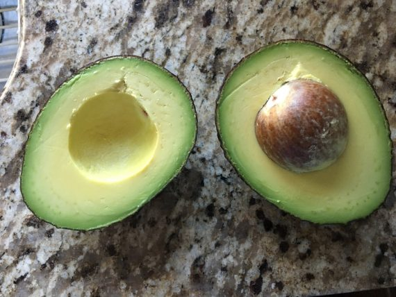 ripe avocado cut in half