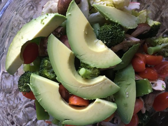 salad topped with avocado