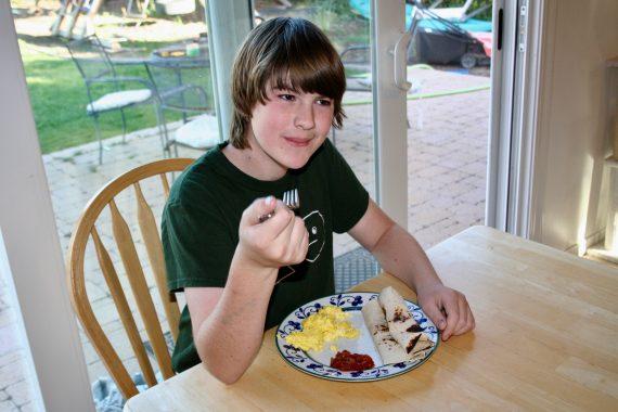 boy eating eggs
