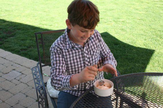 boy smiling at ice cream